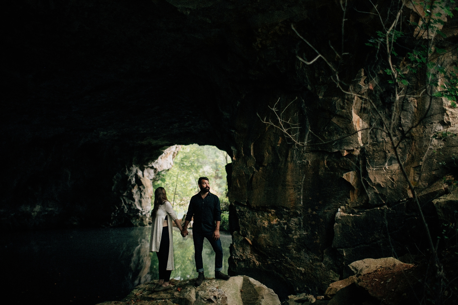 couple-standing-in-cave