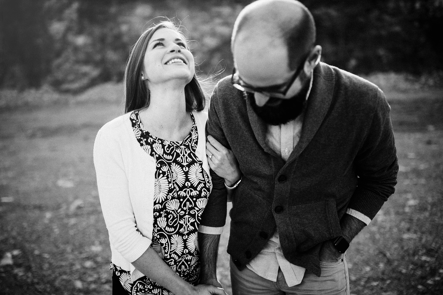 couple laughing holding hands