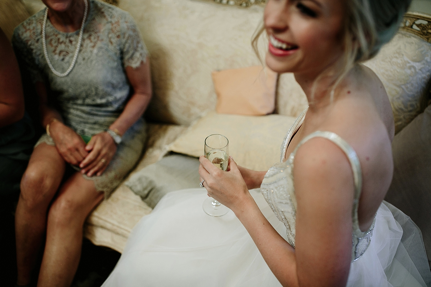 bride holding personalized champagne glass