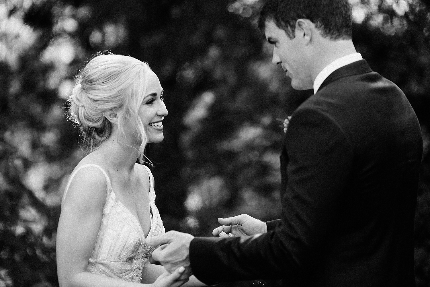 bride and groom holding hands and laughing