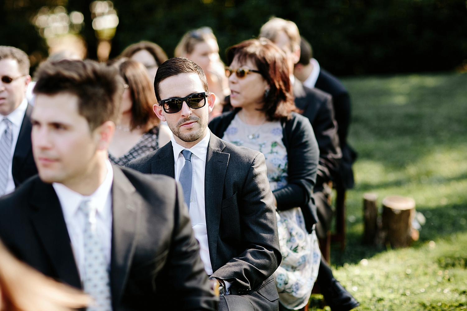 guest with sunglasses sitting in ceremony chair