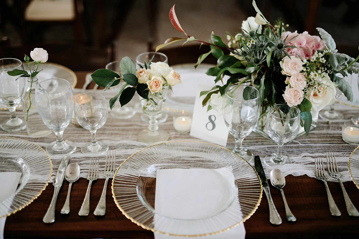 gold rimmed plates with silver silverware