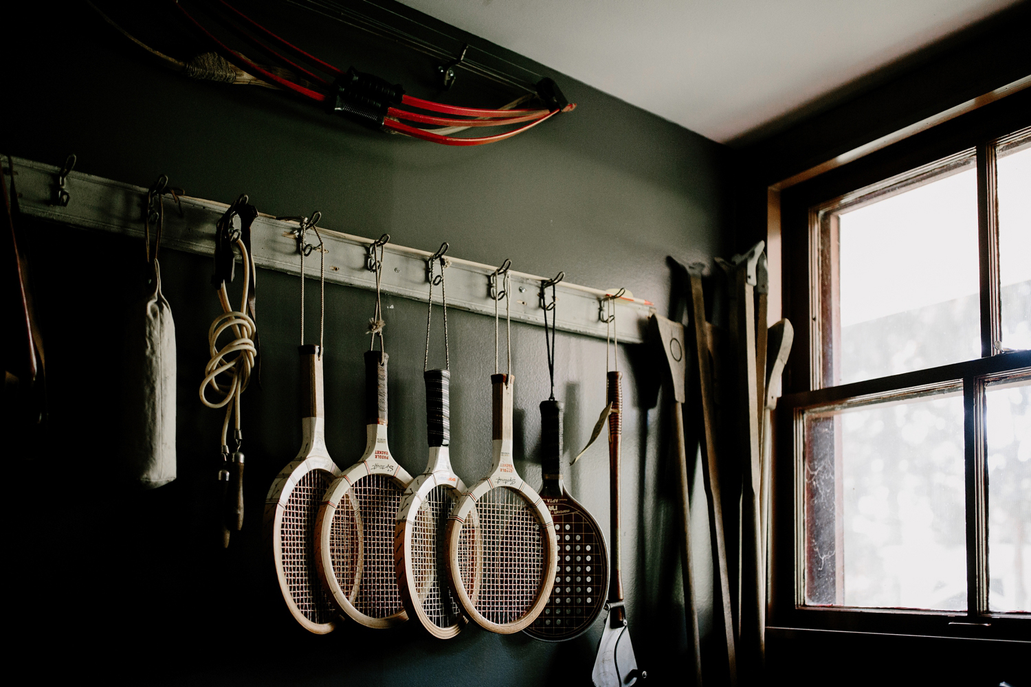vintage tennis rackets in window