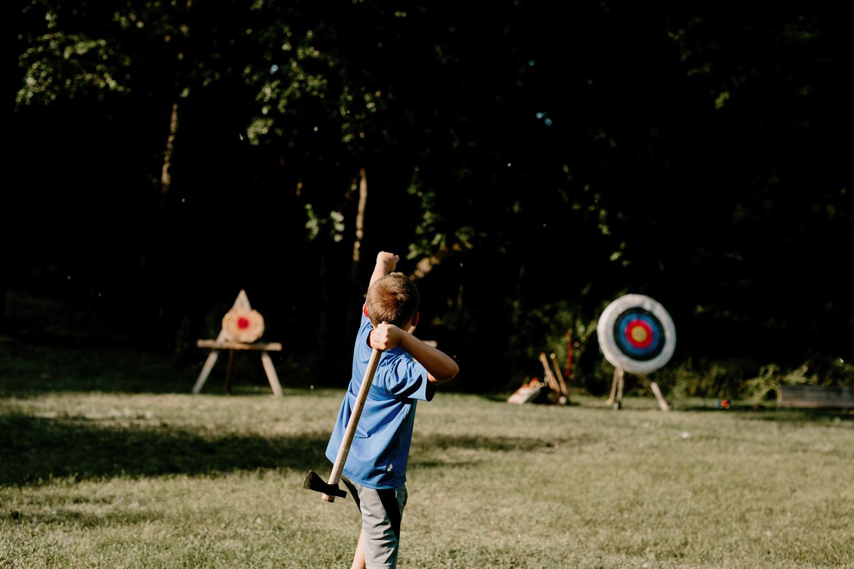 Boy throwing axe at target