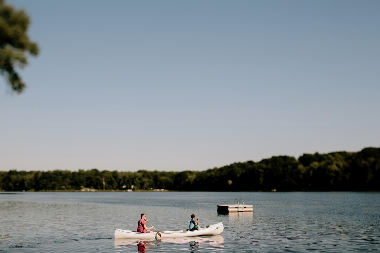 kids riding in vintage canoe