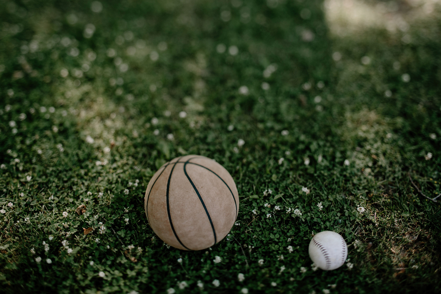 basketball and softball laying on ground