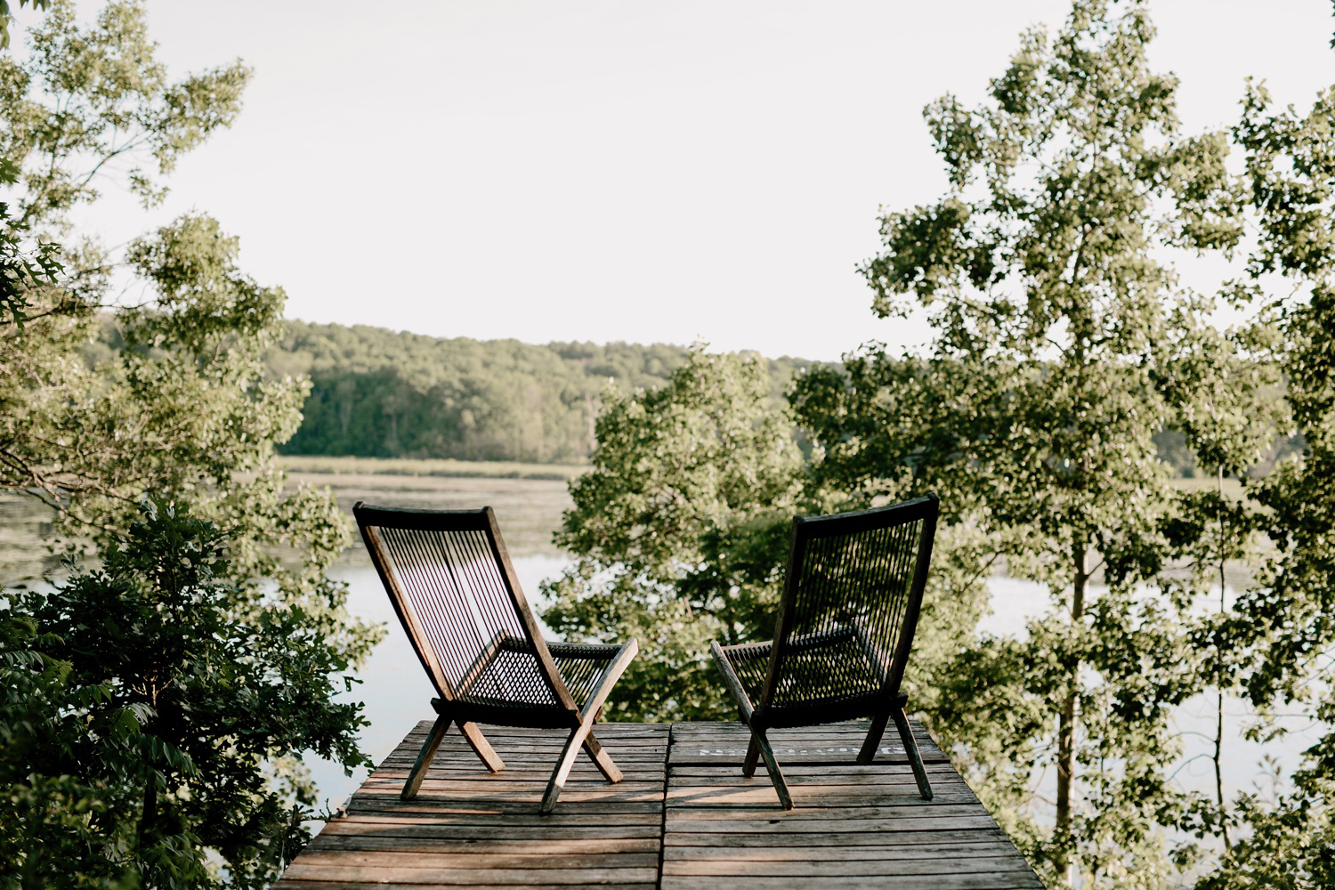 wooden chairs on dock