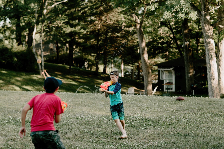 boys having a water gun fight