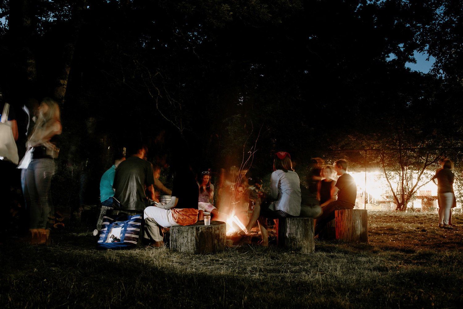 group of people around bonfire