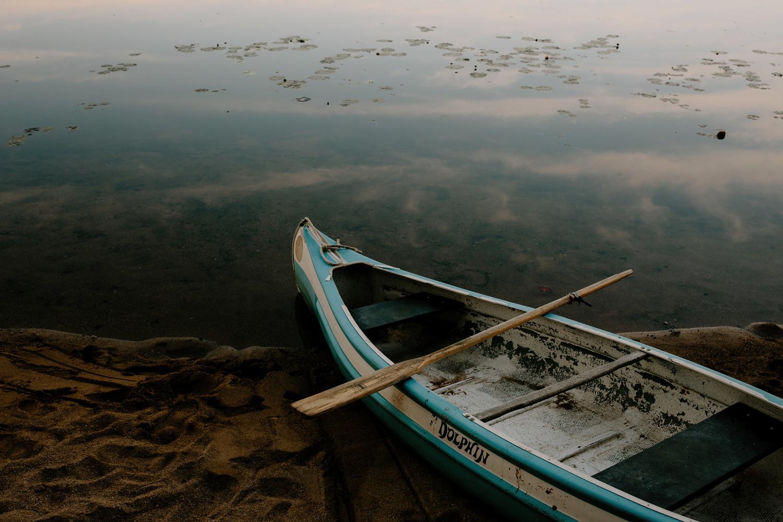 old boat on lake at dawn