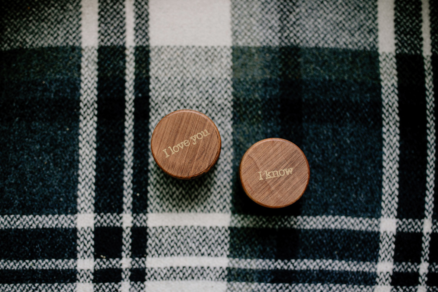 cute wooden ring boxes on plaid blanket