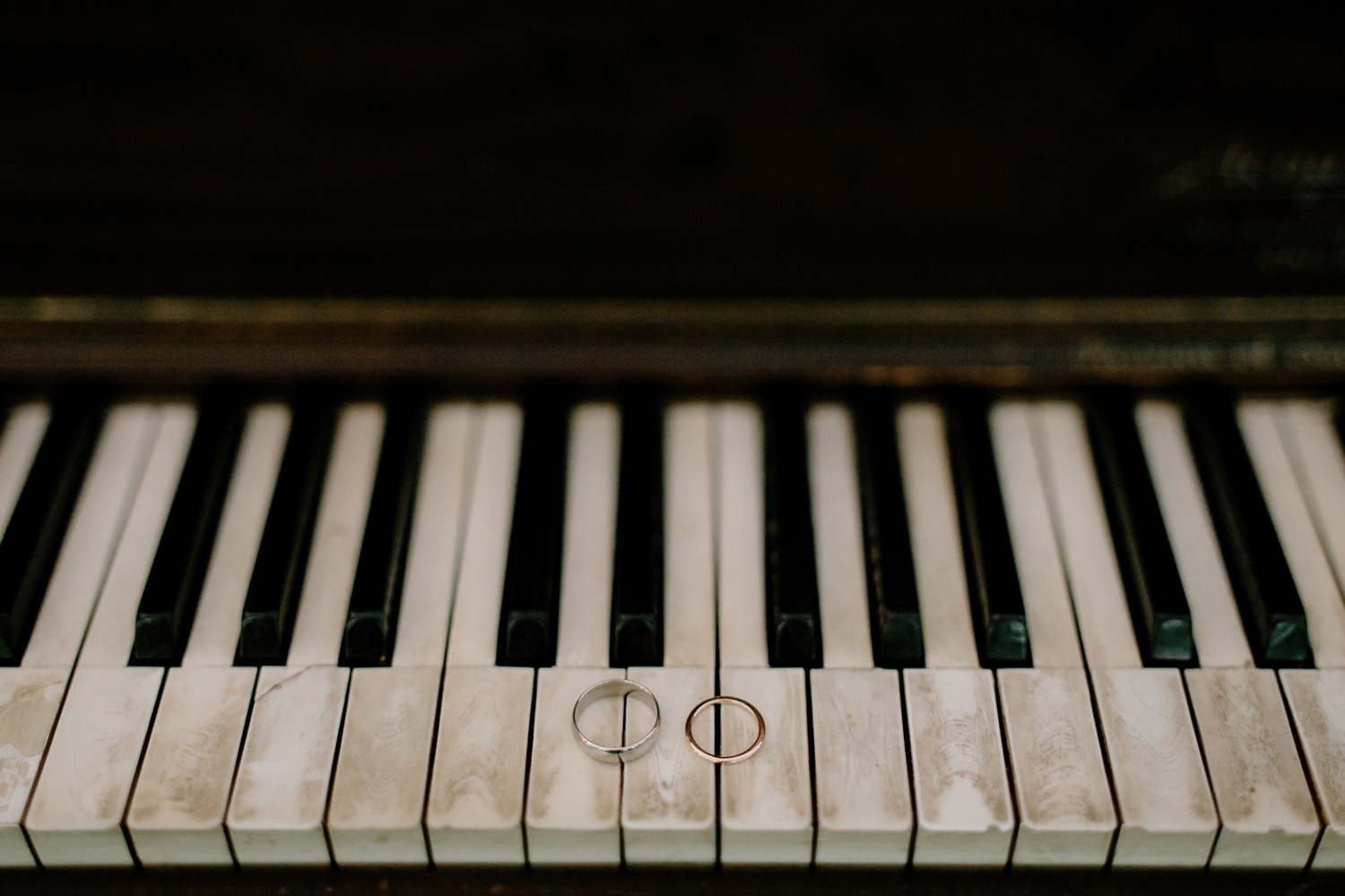 wedding rings on old piano