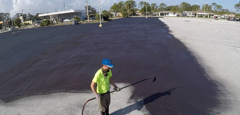 Sealcoating with a spray system