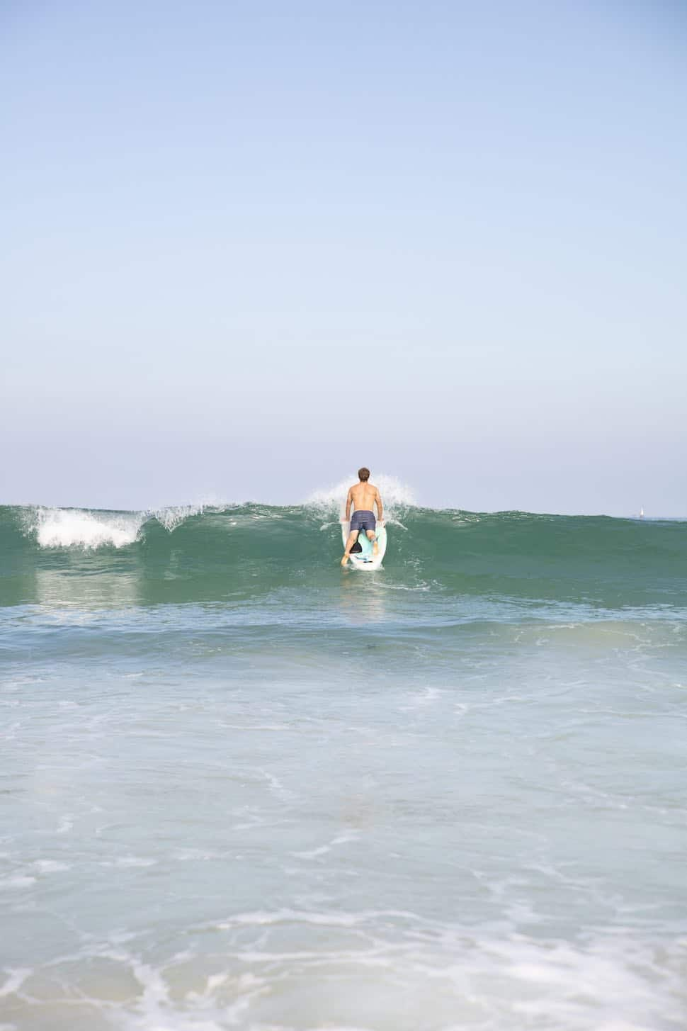 Thurso-Surf-Blog-SUP-Surfboard-Exercise-3-Drills-to-Help-Improve-Your-Surfing-man-paddles-out-over-breaking-wave-on-Thurso-Surf-Waterwalker-All-around-SUP