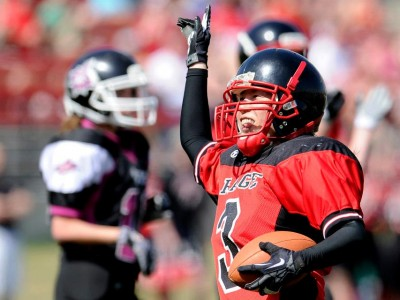 Hong celebrates after a touchdown against Grande Prairie (Image by Candice Ward)