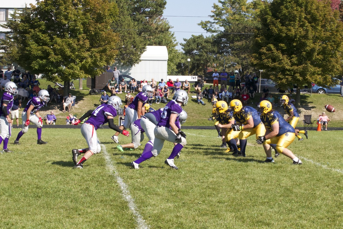 The Holy Trinity defensive line and the Paul Dwyer offensive line bust off the ball. Photo by Paige Daley