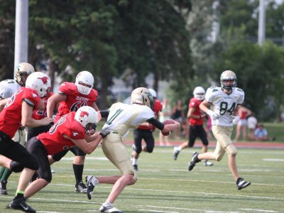 Tristan ferenczy (in the red) attempts to tackle an opposing player.