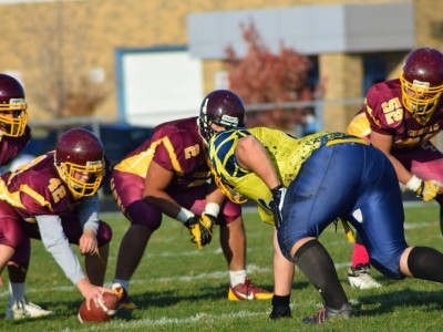 Tyler Mckenzie (Yellow) lines up before a play.