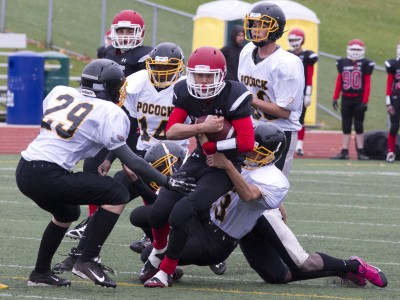 St. Marcellinus quarterback Kevin Wong (8) finds himself surrounded by Philip Pocock defenders in junior football action at St. Marcellinus on Wednesday.
