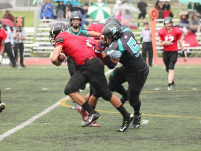 Saturday, May 30: Connor Sykes goes for the tackle against a Mississauga Warriors player.  By Kathy Guenette