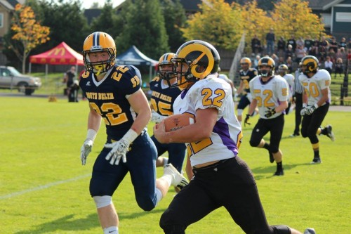 Declann Michielin scored two touchdowns, rushed for 103 yards, registered right tackles and two interceptions (photo credit: Mount Douglas Rams)