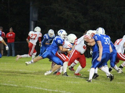 Sept. 11, 2015: Maddock (#52) tackles a player from Lindsay Thurber. By Mrs. Maddock