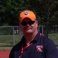 """at 6'4"""" 270lbs Coach Ray Moon is an imposing figure on the football field. Yet player's say he is a gentle giant with their best interests at heart."""