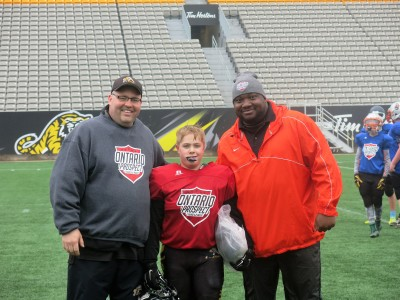 JD Shoniker (#99) with Jeff Ferrell (left) and Barry Trench (right).