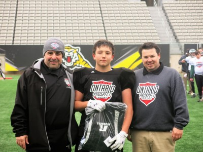 Jayden Banks (#24) with Raad Raad (left) and Rich Lechance (right).