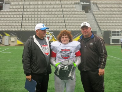 Julian Decareful (#92) with JP Ouellette (left) and Jeff Koradi (right).