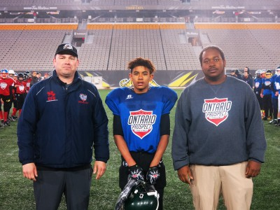 Kallan Edwards (#8) with Nicholas Lazar (left) and Chivase Bryan (right).