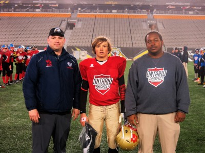 Daniel Brown (#4) with Nicholas Lazar (left) and Chivase Bryan (right).