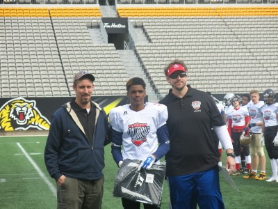 Kevin Victome (#11) with Peter Wilson (left) and Sebastian Tetreault (right).