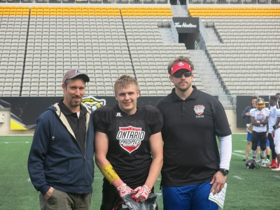 Donovan Moore (#66) with Peter Wilson (left) and Sebastian Tetreault (right).