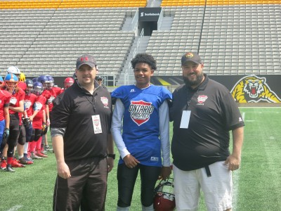 Israel Braithwaite (#28) with Gary Gerard (left) and Shawn McIntyre (right).