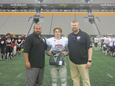 James Keenan (#6) with Joe Wade (left) and Brock Flemming (right).