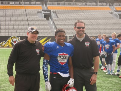 Adre Simmonds (#3) with Larry Bone (left) and Len Gurr (right).