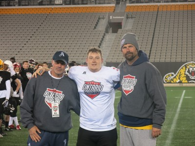 Patrick Madore (#11) with Tony Mandalfini (left) and Blaine Scetherd (right).