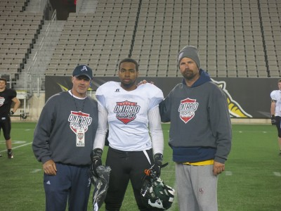 Shamond Carlisle (#28) with Tony Mandalfino (left) and Blaine Scetherd (right).