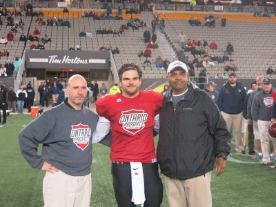 Austin Pilato (#25) with Rick Wood (left) and Mike Solanki (right).