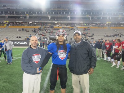 Ronan Macphail-Silver (#24) with Rick Wood (left) and Mike Solanki (right)