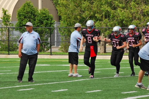 Zack Beno (#8) leads his team out onto the field. Courtesy of CFC.