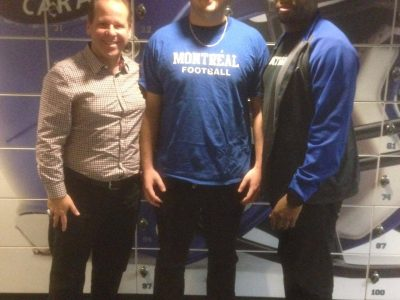 Cédric Mignault (centre) with the Carabins coaches. Courtesy of Cédric Mignault.