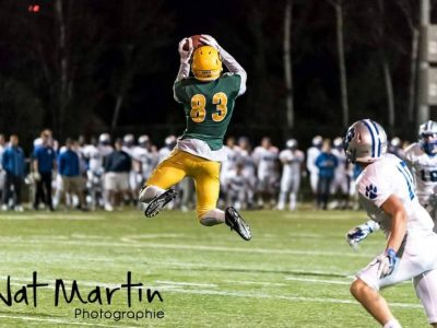 Hugo Dupuis jumps for the ball. By Nathalie Martin.