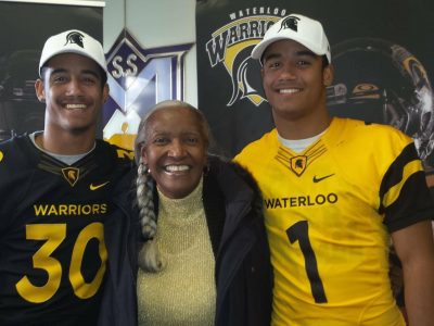 Tre Ford (right, #1) and Tryell Ford (left, #30) celebrate their signing with Waterloo with their grandmother. Courtesy of Tre Ford.