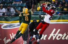 Calgary Stampeders' Simon Charbonneau-Campeau, right, makes a a catch as Edmonton Eskimos' Cauchy Muamba looks on during first half CFL West Division final football action in Edmonton, Sunday, Nov. 22, 2015.THE CANADIAN PRESS/Jeff McIntosh