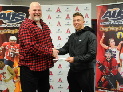 Acadia Head Coach Jeff Cummins welcomes Mason Brown to the team. Courtesy of Jeff Cummins.