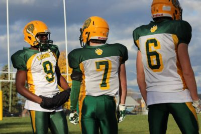 Richard Cole (#9) with his teammates on the sideline during a game