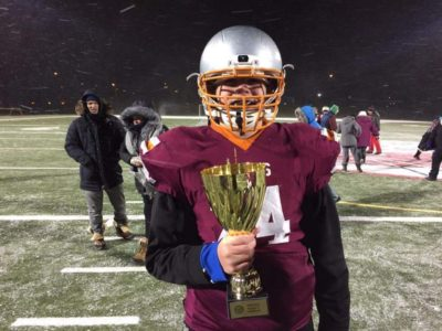 Devon Martin holds a trophy after a game