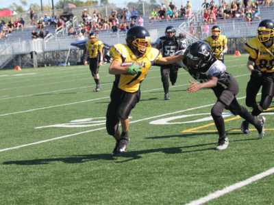 Aaron Arteaga carries the ball during a game